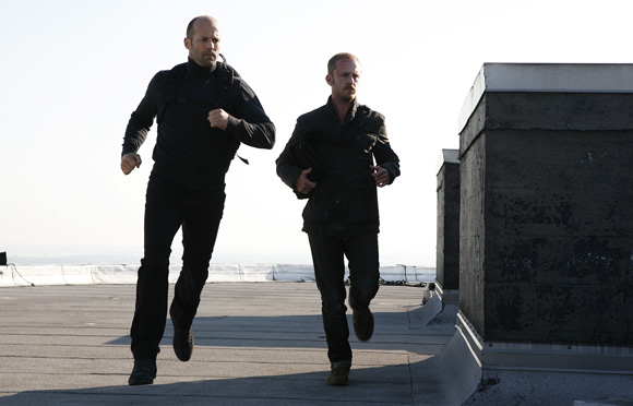 Jason Statham and Ben Foster in The Mechanic