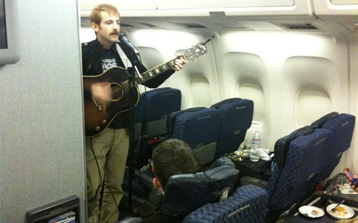 Sad Brad Performing on the Plane